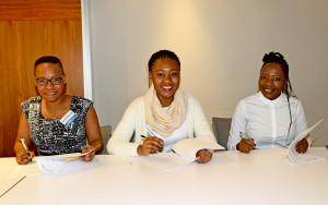 aecom-educational-trust-recipients-doreen-pamela-and-bridget-signing-their-contracts